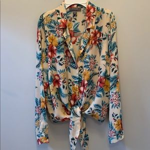 Primary crop blouse with tie .